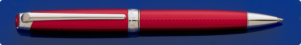 Caran Dache Leman Rouge Carmin Ballpoint Pen - Translucent Carmine Red Lacquer Covers The Milled Cubic Diamond Guilloched Body - Trim Is Silver Plated Rhodium - Twist Activated